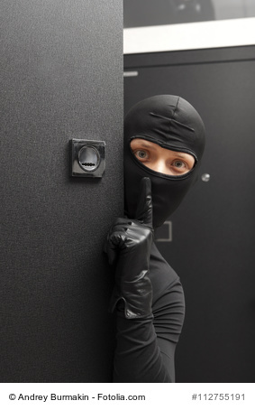 Ninja. Robber hiding behind a door
