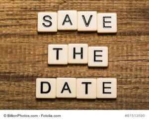 Date. Tablet pc with text Save the Date with sky background