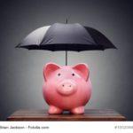 Sparschwein mit Regenschirm